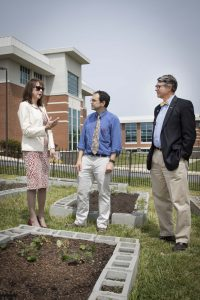 From left, Patricia Moore-Pastides talks to Chris Bender, associate professor of chemistry, and Dr. Tom Moore, chancellor of USC Upstate, about the importance of community gardening. Photo by Les Duggins Sr./USC Upstate Photographer