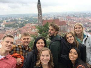 From left, Nick Papstein, Billy Reece, Monica Rojas, Kathryn DuCharme, Jacob Forman, Emily Flint, Catalina Fernandez, Lonneke Nijland are pictured at St. Martin's Church in Landshut.