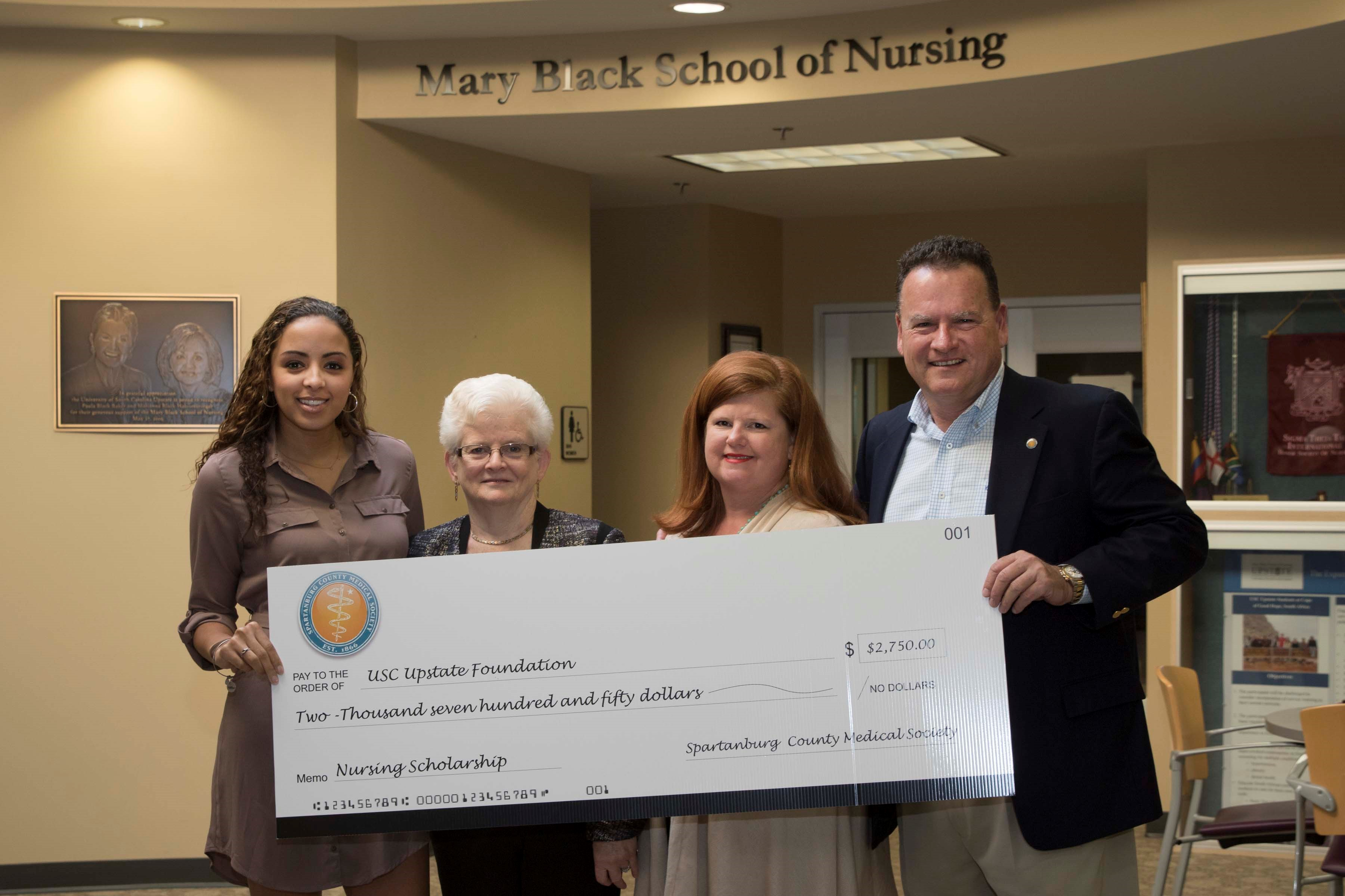 From left, Kayla McAvoy, Dr. Katharine Gibb, dean of the Mary Black School of Nursing at USC Upstate, Bea Walters Smith, director of development and foundation scholarships at USC Upstate Foundation, and Robert Conner, executive director of the Spartanburg County Medical Society.
