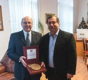 From left, Professor RNDr. Pavol Sovák, rector of the Pavol Jozef Šafárik University, presents Dr. Vince Connors with the Commemorative Medal of the Pavol Jozef Šafárik University in Košice on December 19, 2016.